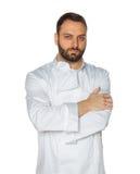 Jonge chef-kok op witte achtergrond Stock Foto's