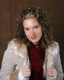 Jonge dame in een de winterjasje royalty-vrije stock foto