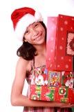 Jonge dame met Kerstmisgiften stock fotografie