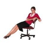 Jonge dame op bureaustoel Stock Foto