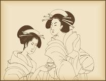 Jonge dames die thee drinken Royalty-vrije Stock Afbeeldingen