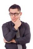 Jonge denkende die mens op wit wordt geïsoleerd Royalty-vrije Stock Foto's