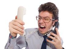 Jonge die call centrewerknemer op wit wordt geïsoleerd Royalty-vrije Stock Foto's