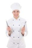 Jonge die vrouw in chef-kok eenvormig met vork en mes op whit wordt geïsoleerd Royalty-vrije Stock Foto