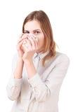 Jonge die vrouw het drinken koffie op wit wordt geïsoleerd stock foto