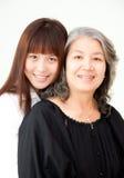Jonge en hogere Aziatische vrouwen Royalty-vrije Stock Foto's