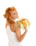 Jonge en sexy redhead bruid met een boeket royalty-vrije stock foto