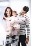 Jonge familie met babymeisje Stock Afbeelding