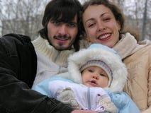 Jonge familie van drie stock afbeelding