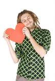 Jonge geïsoleerdeo dreadlockmens met rood document hart stock afbeelding