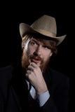 Jonge gebaarde mens in een hoed Stock Foto
