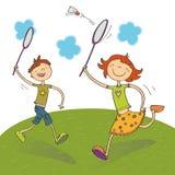Jonge geitjes die badminton spelen Royalty-vrije Stock Foto