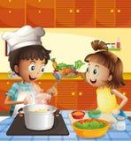 Jonge geitjes die bij de keuken koken Stock Afbeelding