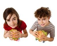 Jonge geitjes die gezonde sandwiches eten stock afbeelding