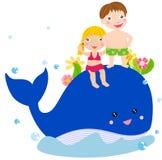 Jonge geitjes en walvis Royalty-vrije Stock Foto
