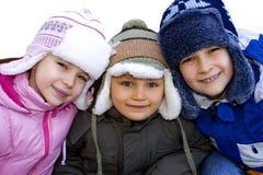 Jonge geitjes Gekleed voor de Winter stock foto's
