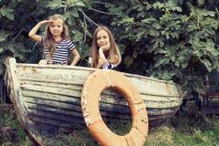 Jonge geitjes met raad Royalty-vrije Stock Fotografie