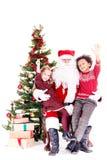 Jonge geitjes met Santa Claus stock fotografie