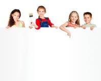 Jonge geitjes met witte banner Stock Foto