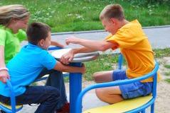Jonge geitjes op speelplaats Royalty-vrije Stock Foto's