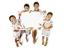 Jonge geitjes in Verf met Teken stock fotografie