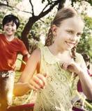 Jonge geitjeskinderen die Gelukconcept spelen royalty-vrije stock foto's
