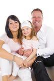 Jonge gelukkige familie Stock Foto's