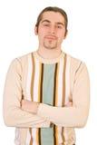 Jonge gelukkige knappe geïsoleerdet mens in sweater Stock Afbeeldingen