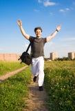 Jonge gelukkige lopende mens Stock Foto