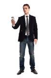 Jonge gelukkige mens die mobiele telefoon houdt Stock Afbeelding