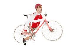 Jonge gelukkige mens zijn fiets houden die stellend zoals spelend stock foto's