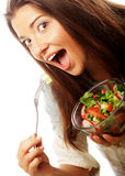 Jonge gelukkige vrouw die salade eet stock foto's