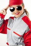 Jonge gelukkige vrouw die werktuigkundigenoverall draagt stock afbeelding