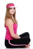 Jonge geschikte vrouw die op witte achtergrond wordt geïsoleerde Stock Afbeelding
