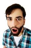 Jonge geschokte mens met open mond stock afbeelding