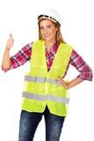 Jonge glimlach vrouwelijke bouwer in vest stock afbeelding