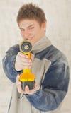Jonge glimlachende bouwer in de bouw Stock Foto's