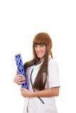 Jonge glimlachende vrouwelijke arts in witte eenvormig Royalty-vrije Stock Foto's