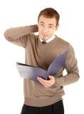 Jonge goed-geklede denkende mens met documenten Royalty-vrije Stock Foto's