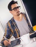 Jonge grafische ontwerper Stock Foto