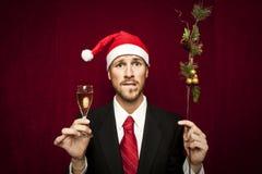 Jonge grappige kerel met Kerstmishoed Royalty-vrije Stock Afbeelding