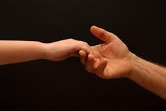 Jonge hand voor hulp stock afbeeldingen