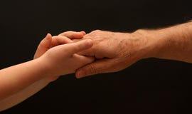 Jonge hand voor hulp Stock Afbeelding