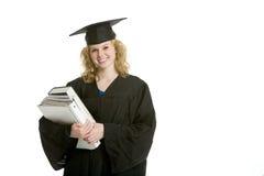 Jonge het glimlachen de holdingsboeken van het graduatiemeisje Royalty-vrije Stock Foto's
