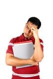 Jonge Indische student die zijn hoofd in spanning houdt. Stock Foto