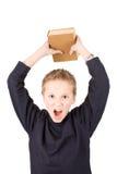Jonge jongen boos met een boek Royalty-vrije Stock Afbeeldingen