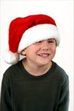 Jonge jongen in een lach van de santahoed royalty-vrije stock afbeeldingen