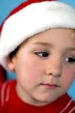 Jonge jongen in een santahoed Stock Foto's