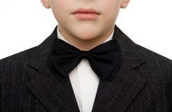 Jonge jongen in kostuum Stock Afbeelding