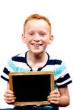 Jonge jongen met bord Stock Foto
